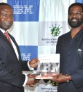 Joe Mensah, Country General Manager, IBM Ghana (left) presents an IBM Smarter Cities report on Accra, Ghana to the city's Mayor, Alfred Vanderpujie. (PRNewsFoto/IBM)